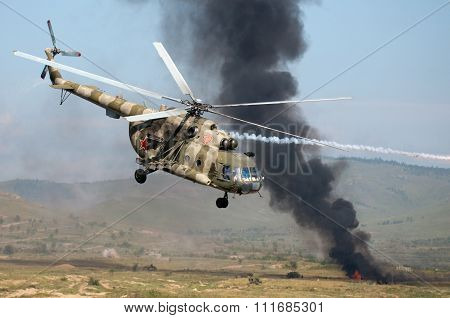 Helicopters Mounting A Ground Attack With Explosions And Smoke