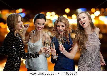 celebration, friends, bachelorette party, nightlife and holidays concept - happy women clinking champagne glasses and dancing over night lights background