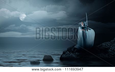 Young elven girl with sword on sea coast