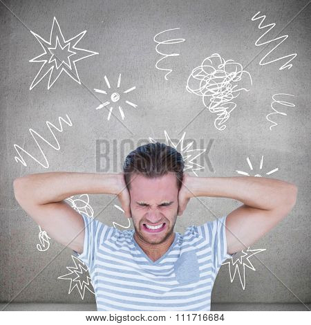 Handsome casual man screaming with hand on ears against grey room
