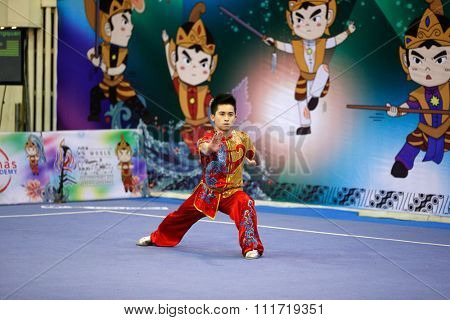 JAKARTA, INDONESIA - NOVEMBER 17, 2015: Wong Weng Son of Malaysia performs the movements in the men's Compulsory Changquan event in the 13th World Wushu Championship 2015 in Istora Senayan Stadium.
