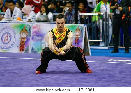JAKARTA, INDONESIA - NOVEMBER 17, 2015: Arlain Geraedts of the Netherlands performs the movements in the men's Compulsory Changquan event at the 13th World Wushu Championship 2015 Jakarta.