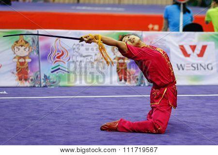 JAKARTA, INDONESIA - NOVEMBER 17, 2015: Sapna Yumlembam of India performs the movements in the women's Jianshu event at the 13th World Wushu Championship 2015 in Istora Senayan Stadium.