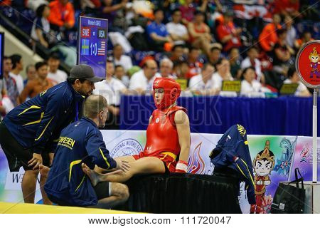 JAKARTA, INDONESIA - NOVEMBER 17, 2015: Elin Oberg of Sweden (red) fights Ragan Beedy of the USA (black) in the women's 56kg Sanda event at the 13th World Wushu Championship 2015.