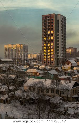 Winter City And Village Homes With Snow