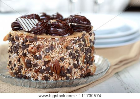 Whole German Chocolate Cake with plates and Champagne glasses