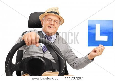 Cheerful senior gentleman holding a plate with an L-sign on it isolated on white background