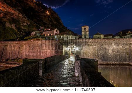 Gate to Kotor ancient fortress at night