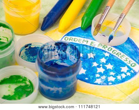 Paints,brushes And Crayons On The Brazil Flag Watercolor Painting