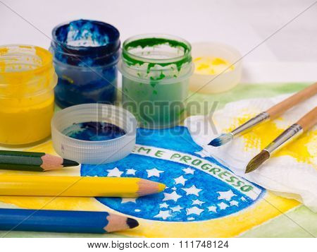 Paints,brushes And Color Pencils On The Brazil Flag Watercolor Painting