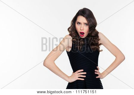 Shoked disturbed pretty young woman with bright makeup in retro style in black dress isolated over white background