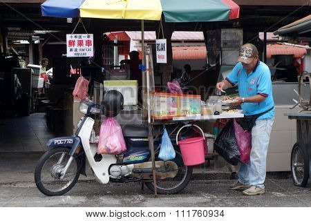 Hawker Sells Rojak On The Road Side In Penang, Malaysia