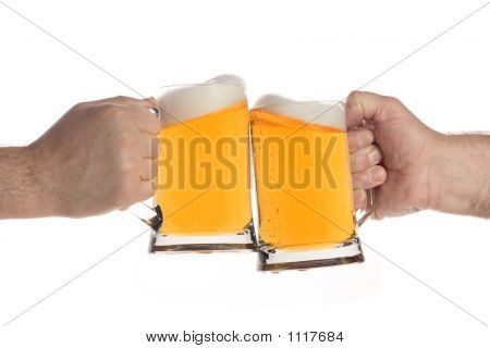 Two People Making A Toast With Beer Mugs