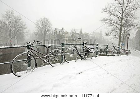 Snowy bikes in Amsterdam innercity in the Netherlands