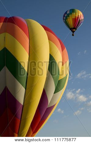 Hot Air Balloons Launching Against A Blue Sky