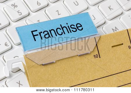 A Brown File Folder Labeled With Franchise