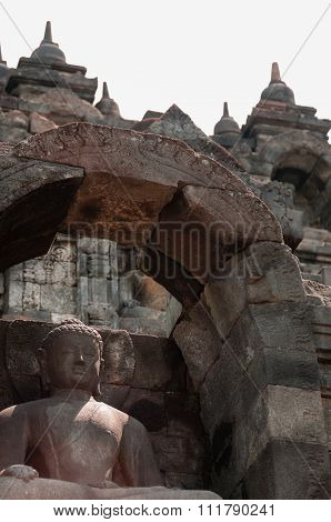 Sitting Buddha in stone at Borobudur
