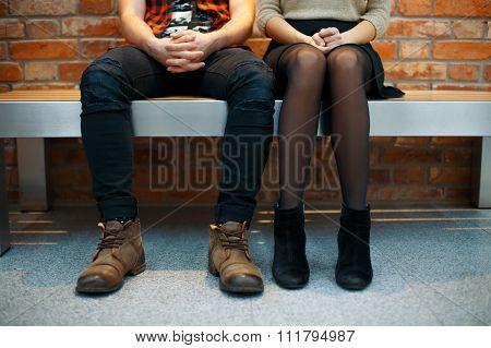 Fashionable Stylish Couple Sitting On The Bench. Legs Close-up