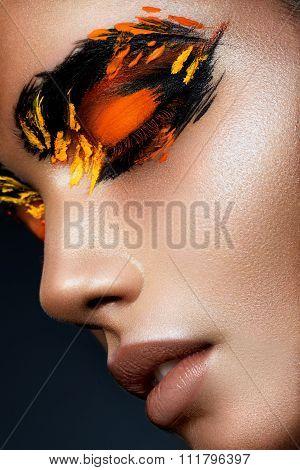 Beauty fashion model girl with dark bright orange make-up