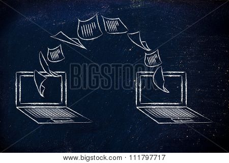 Laptops With Documents Flying From One Screen To The Other