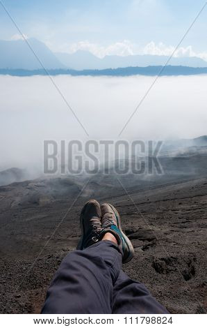 Feet with shoes in front Sheet of Fog smoke or Mist