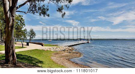 Murrays Beach wharf in the green Murrays Beach waterfront parkland Lake Macquarie New South Wales Australia. poster