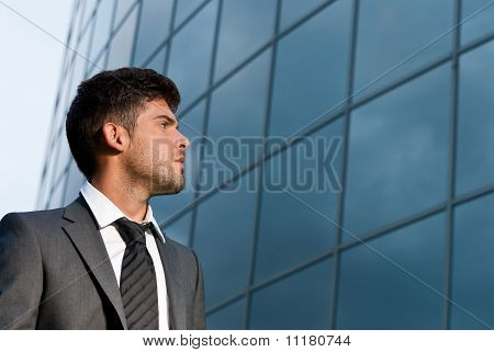 Young Businessman Looking Good Expectations On Modern Building Background