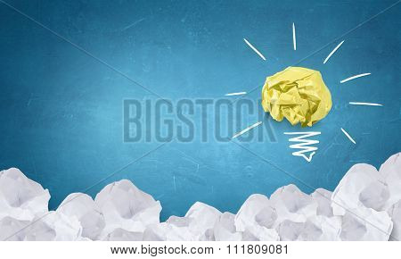 Inspiration concept with crumpled paper as sign for creativity work