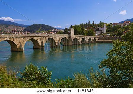 Old Bridge on Drina river in Visegrad - Bosnia and Herzegovina - architecture travel background poster