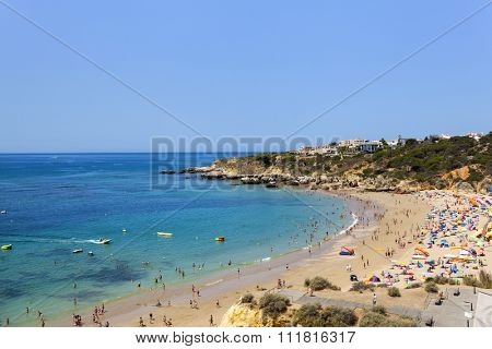 People enjoying the beach of Oura, Albufeira, Algarve