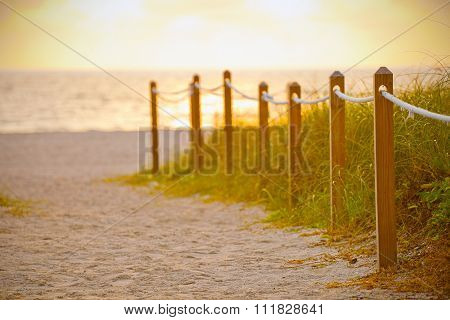 Path on the sand going to the ocean in Miami Beach Florida