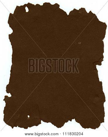 Dark brown sheet of old torn paper