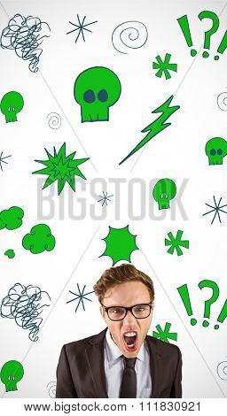 Young angry businessman shouting at camera against swearing doodles