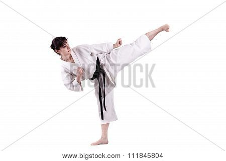 girl exercising karate isolated against white background