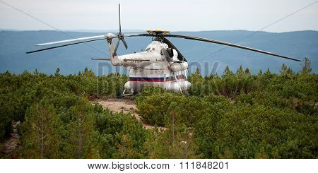 Siberia, Russia - August 27, 2013: Helicopter MI-8 landed on the mountian.