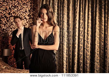 Fashion shot of a beautiful gorgeous couple in a room. Luxury.
