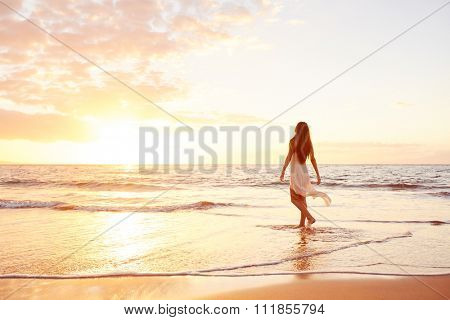 Happy Carefree Woman Enjoying Beautiful Sunset on the Beach