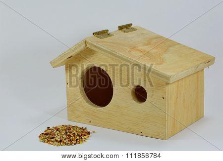 bird food and wooden bird house