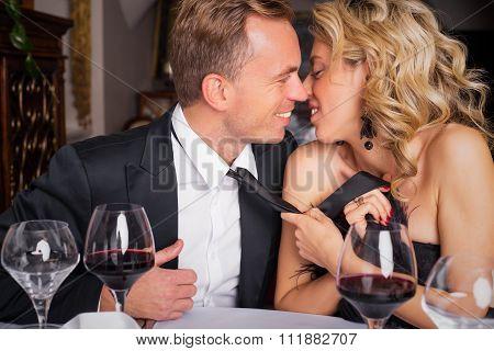 Woman pulling man into kiss
