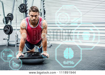 Portrait of muscular man using bosu ball against fitness interface