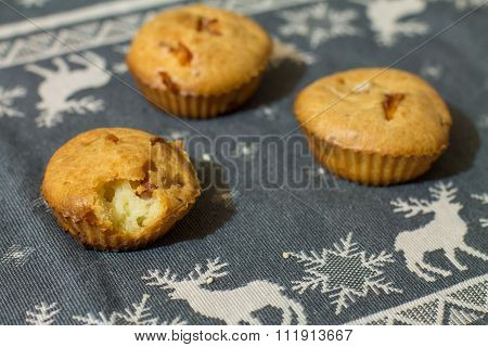 Three salty muffins with sausage, cheese