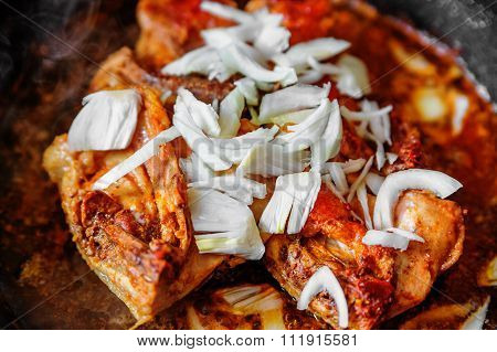 Chicken With Onion On Frying Pan