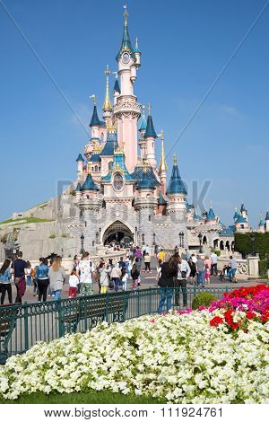 FRANCE, PARIS - SEP 10, 2014: Many tourists are walking near castle of Disneyland.