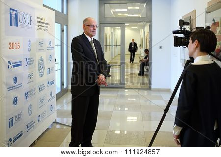 RUSSIA, MOSCOW - 18 MAY, 2015: Journalist is taking interview of the man at conference USRF in MSTU of N.E. Bauman.