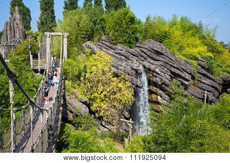 FRANCE, PARIS - 10 SEP, 2014: Waterfall and suspension bridge in Pirates beach on Disneyland.