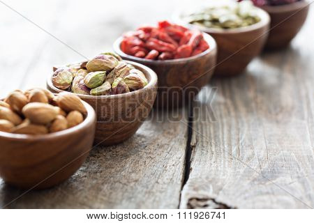 Variety of nuts and dried fruits in small bowls