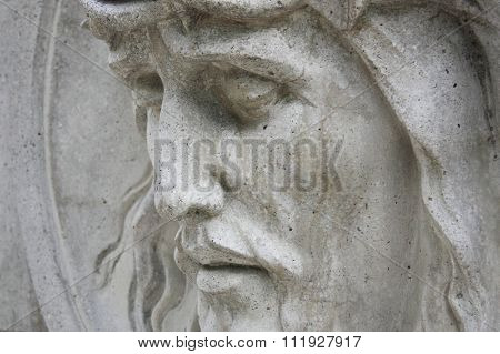 Jesus Christ Statue Against A Background Of Gray Stone (close Up)