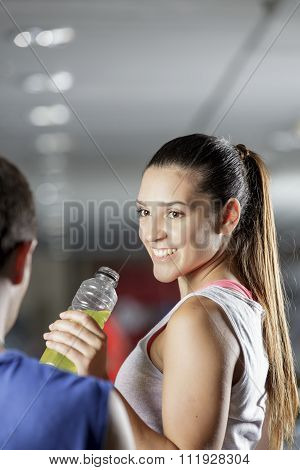 Woman Drinking Energy Drink At The Gym