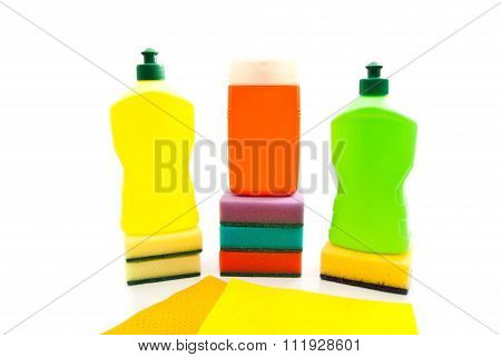 different bottles of detergent rags and sponges on white background poster