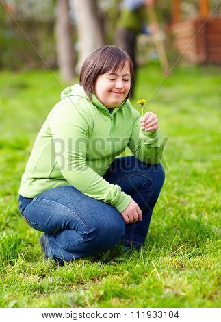 Young Adult Woman With Disability Enjoying Nature In Spring Garden